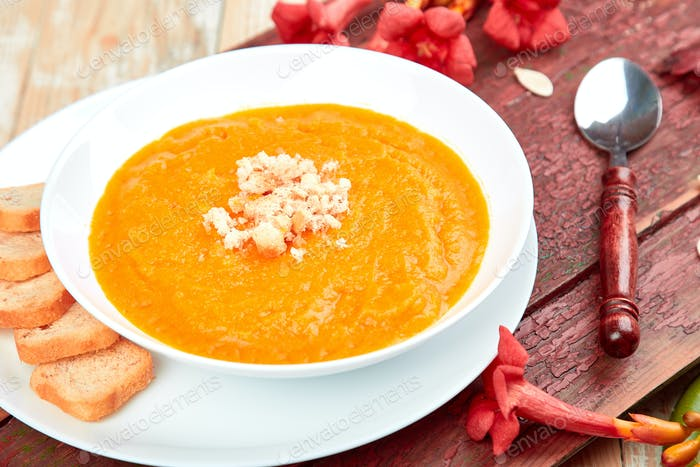 Cream of pumpkin soup in white plate. Thanksgiving Day.