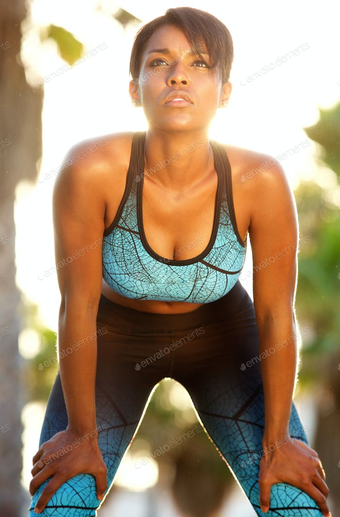 Sporty african american female relaxing after workout