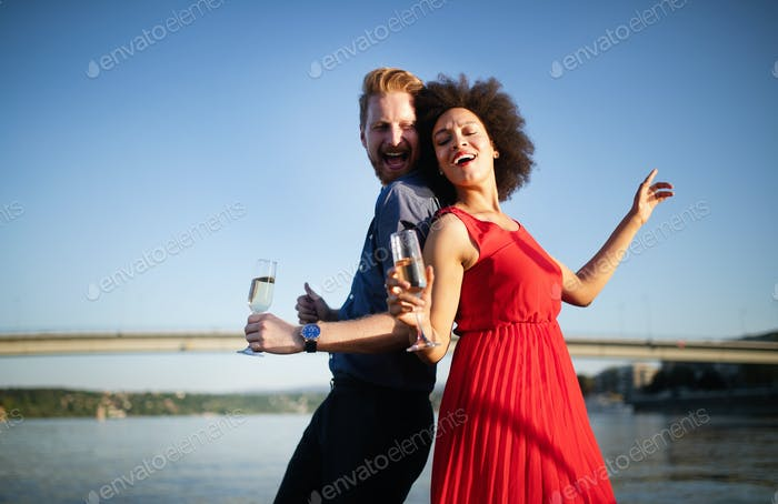 Happy smiling couple in love dancing and flirting