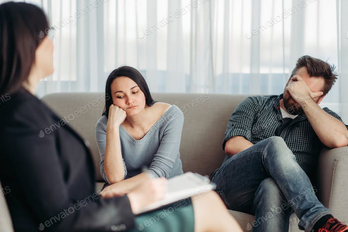 Stressed couple patients at psychologist reception