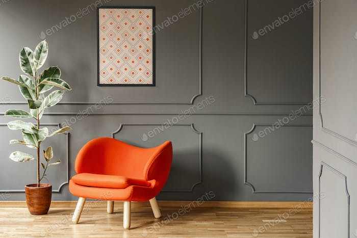 Real photo of open space dark grey living room interior with pos