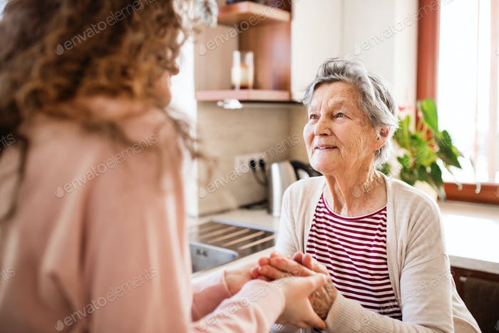 A teenage girl with grandmother at home.