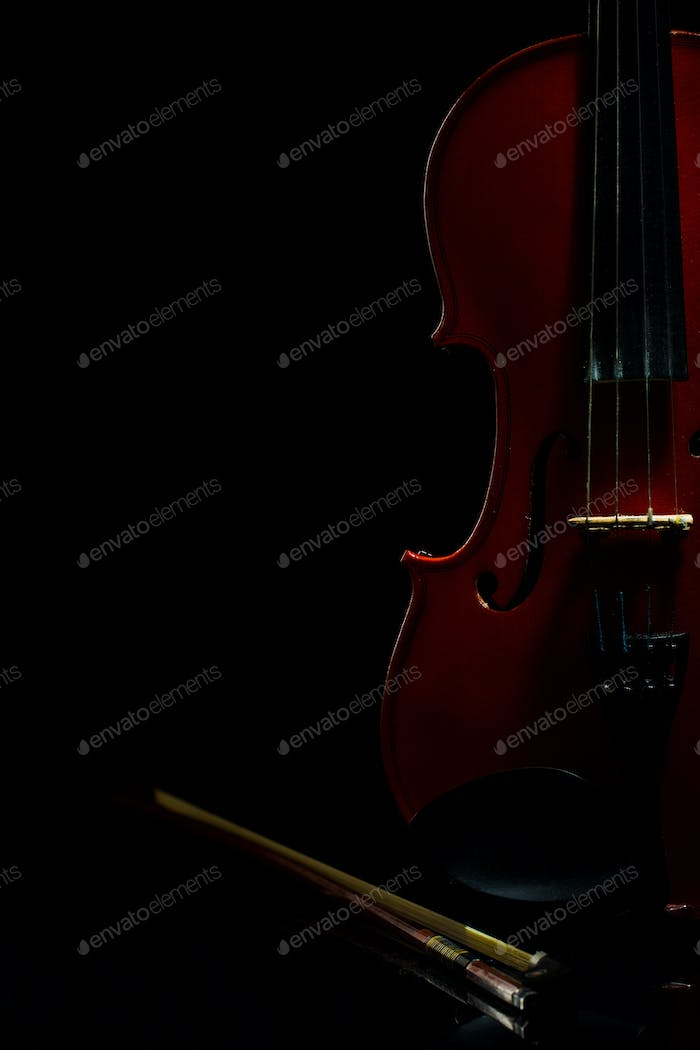 Violin with notes and bow on a black background