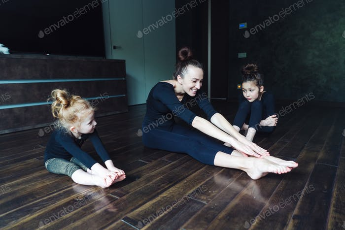 Mom and two daughters spend time together