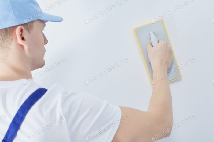 Worker with plastering trowel