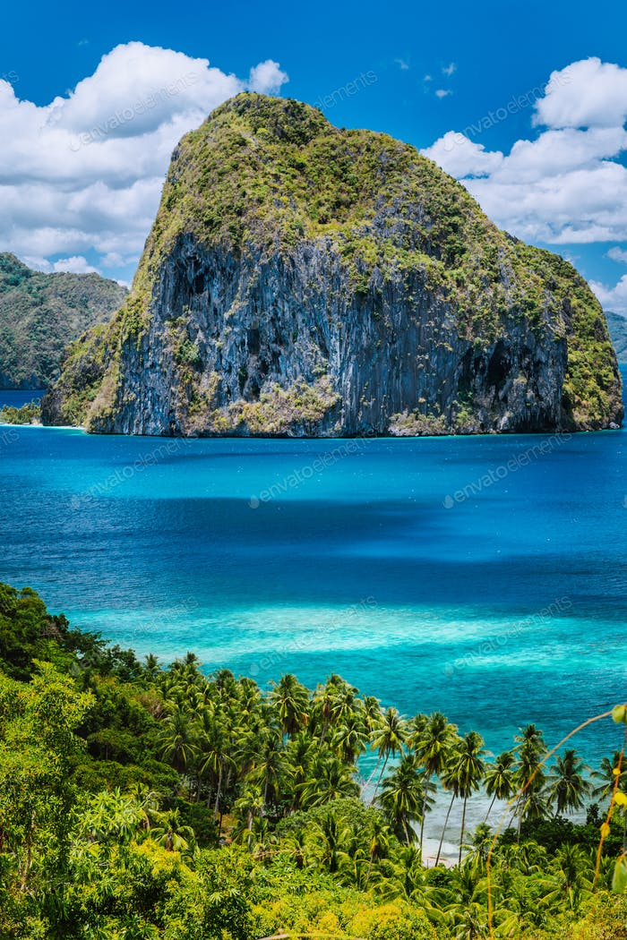 Breathtaking view of tropical coast with jungle and Pinagbuyutan Island in the blue ocean El Nido