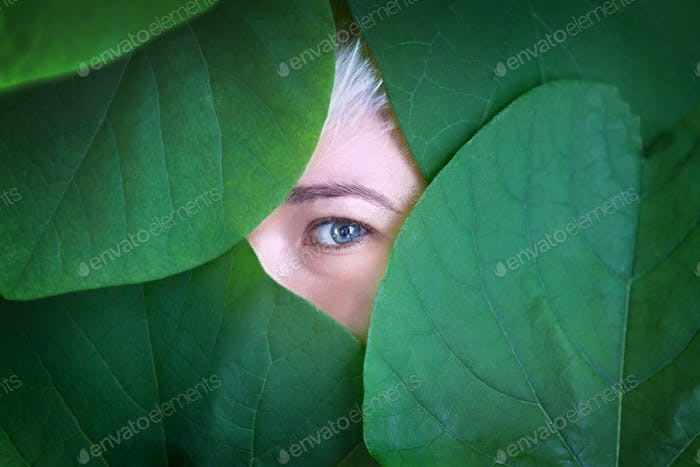Woman behind the leaves