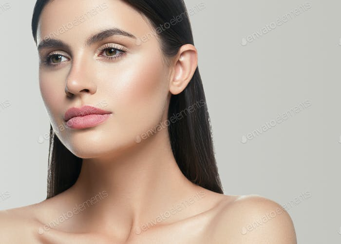 Beauty skin woman face healthy skin beautiful model close up face natural makeup brunette hair.