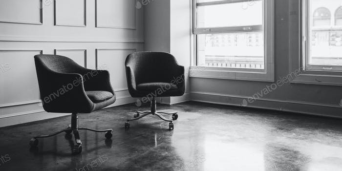 Armchairs in an empty room