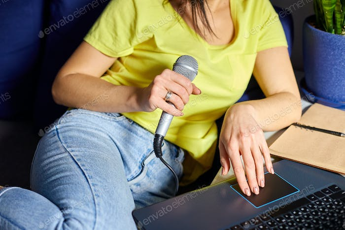 Cheerful woman in casual clothes Recording A Podcast