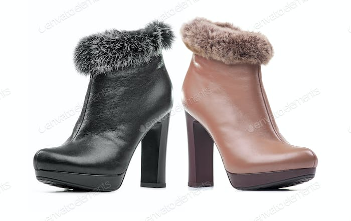 Two female ankle-high boots isolated over white