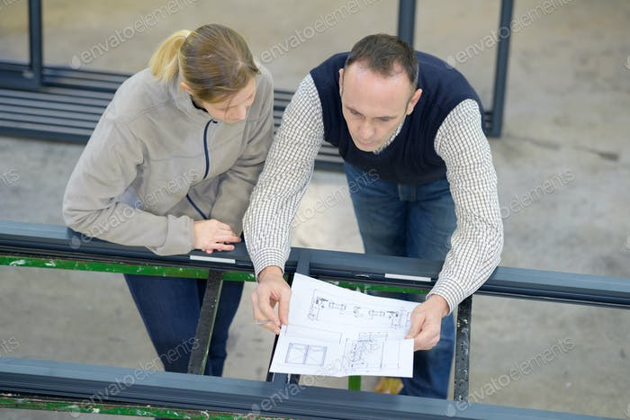 female worker and architect watching some details on a construction
