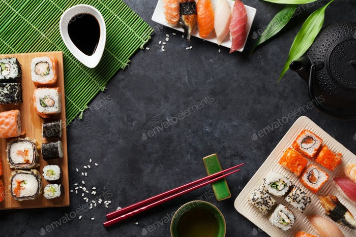 Set of sushi and maki roll and green tea