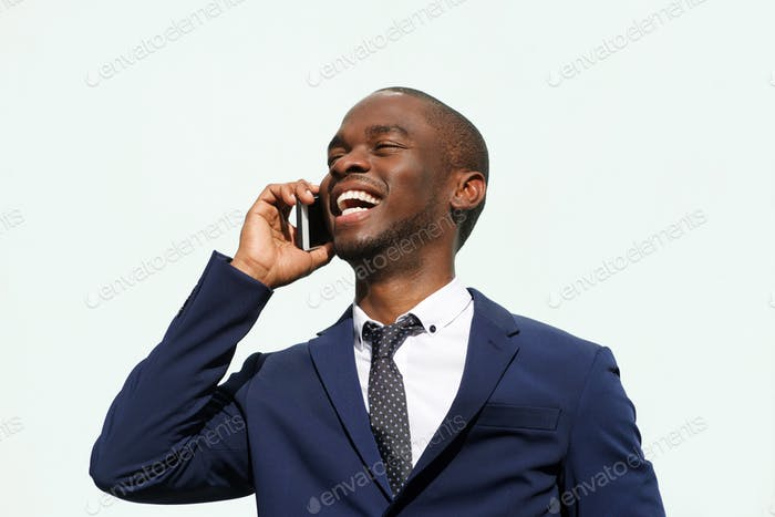 Close up black corporate businessman talking with cellphone outdoors