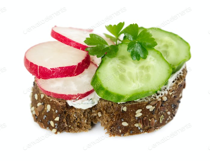 Small sandwich with cucumber, radish and parsley