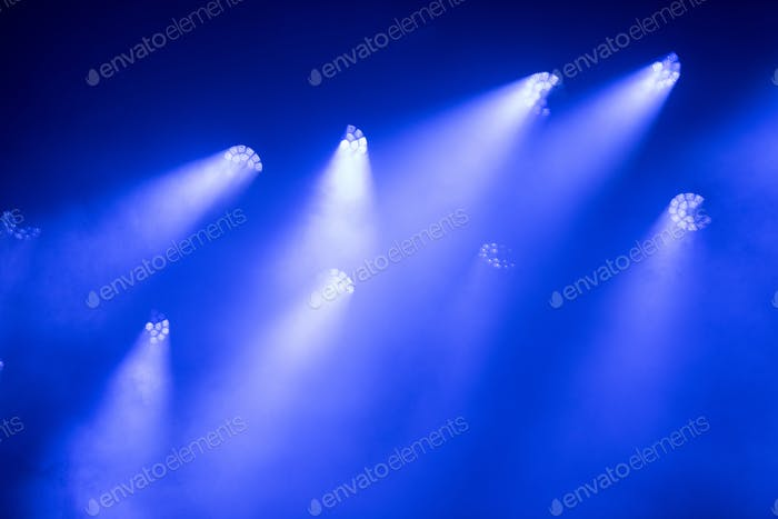 Blue stage lights at music festival