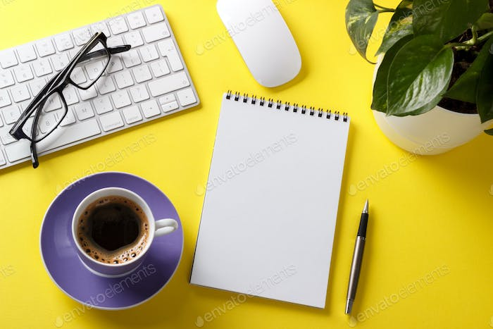 Yellow office desk with stationery