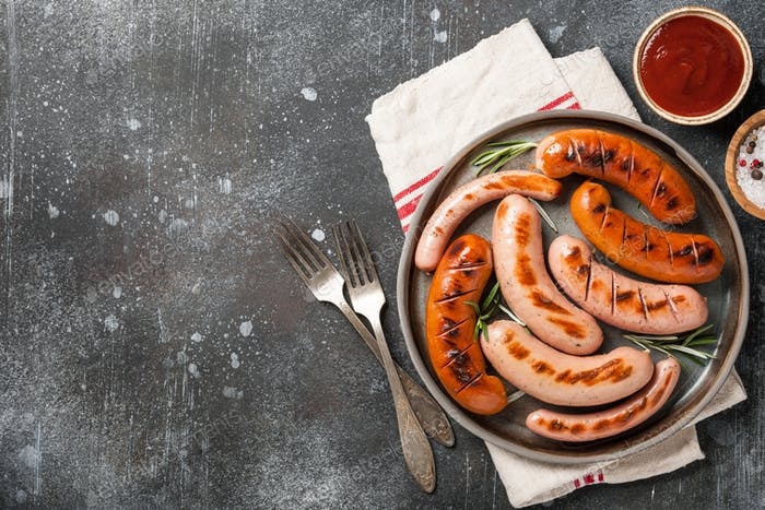Grilled sausages with ketchup and salt