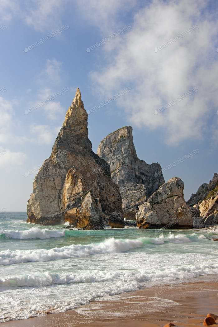 Ursa Beach on the Atlantic coastline has dramatic rock formations called the Giant and the Bear.