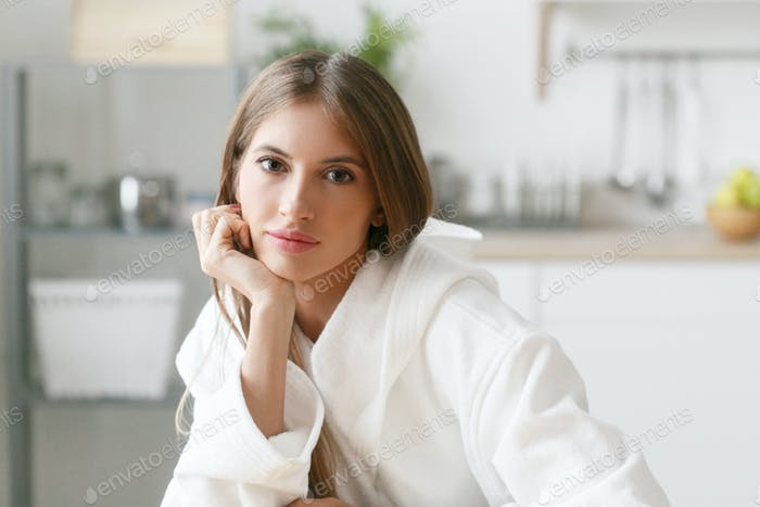Woman on kitchen morning with orange juice and fruits. Positive morning female portrait
