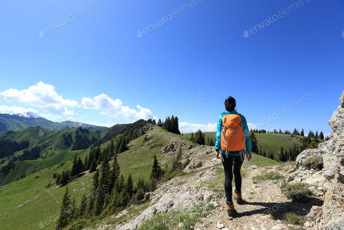 Hiking on mountain top trail