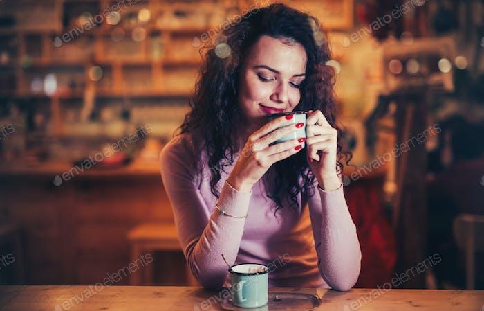 Woman enjoying aromatic coffee