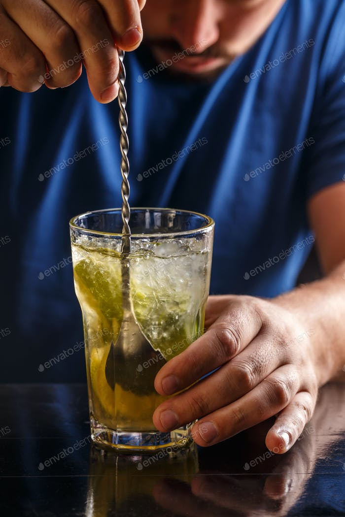 Bartender is stirring cocktails