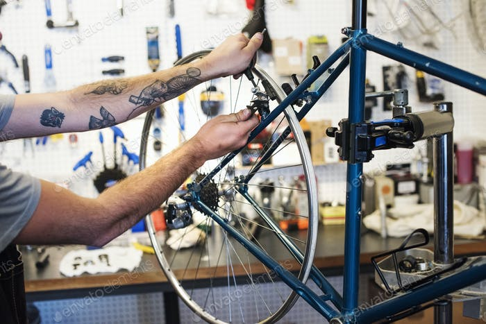 A man working in a bicycle repair shop.