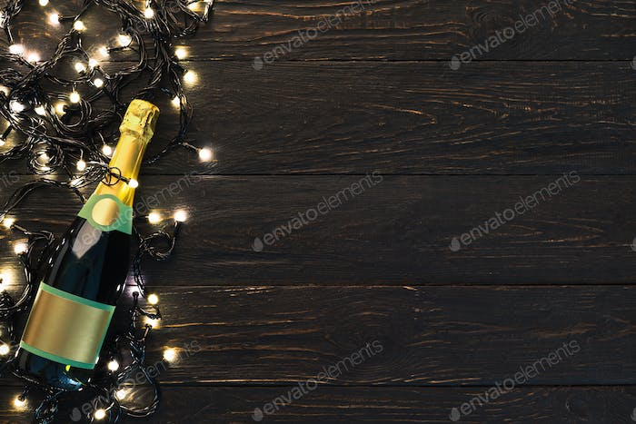 Christmas border of champagne bottle and garland