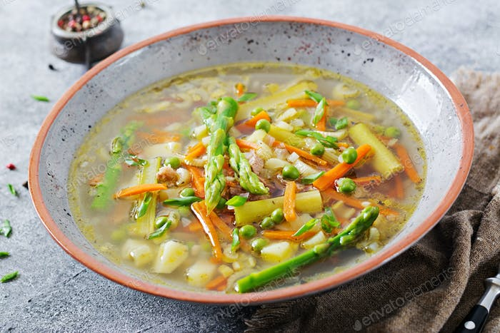 Soup with beef, asparagus, green peas, carrots and celery. Dietary menu. Healthy food.