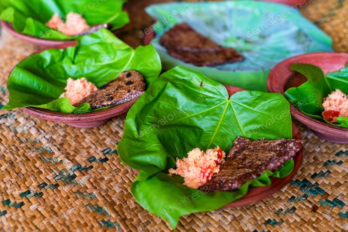 Typical Sri Lankan grains and flatbread on lotus leaf