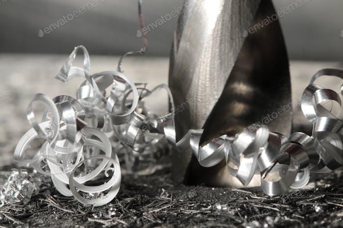 Close-up metal drilling process