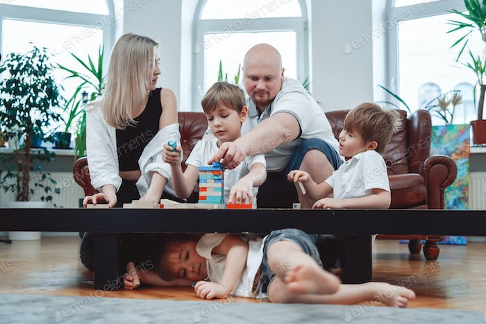 Leisure activity and holidays of caucasian family at home