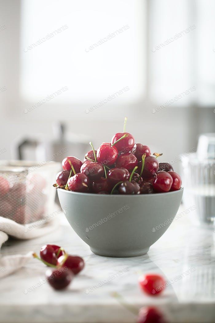 Cherries on white table prepared for breakfast