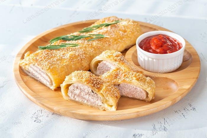 Sausage rolls with tomato sauce