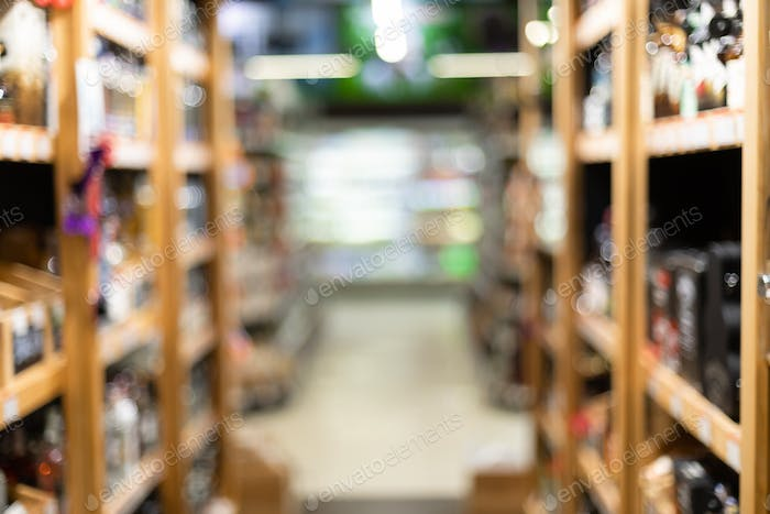 Alcohol Department In Supermaket, Blurred Background Of Wine Shop