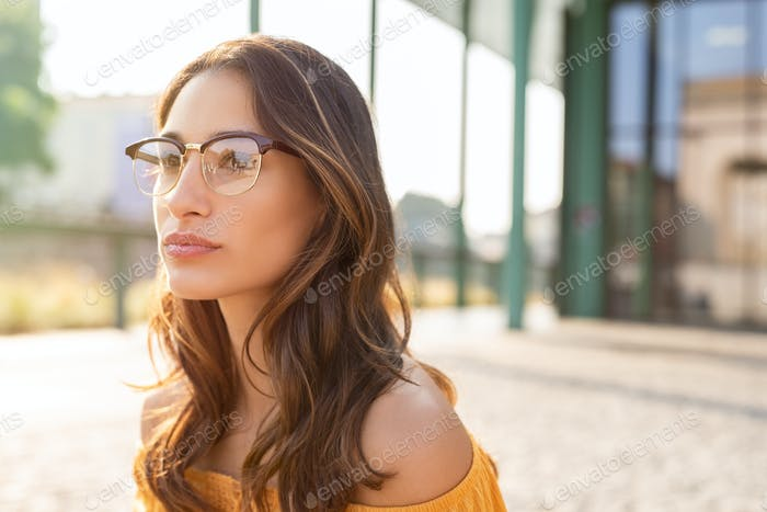 Woman with spectacles thinking