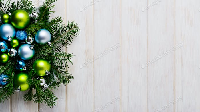Christmas background with green and blue ornaments