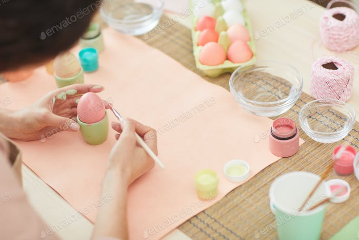 Young Woman Hand-Painting Eggs