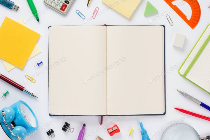 school accessories and open notebook