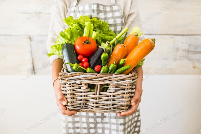 Caucasian woman people with bucket full of coloured and mixed fresh healthy food