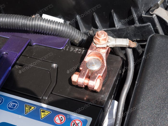 Copper battery terminal of a car close-up