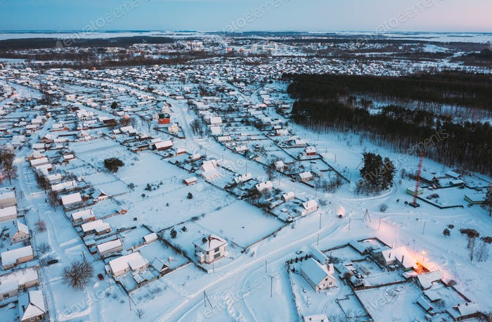 Aerial View Of Town Skyline Winter Evening Night. Snowy Landscape Cityscape Skyline