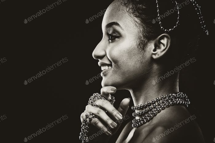 beautiful woman wearing chain jewellery in black and white photo
