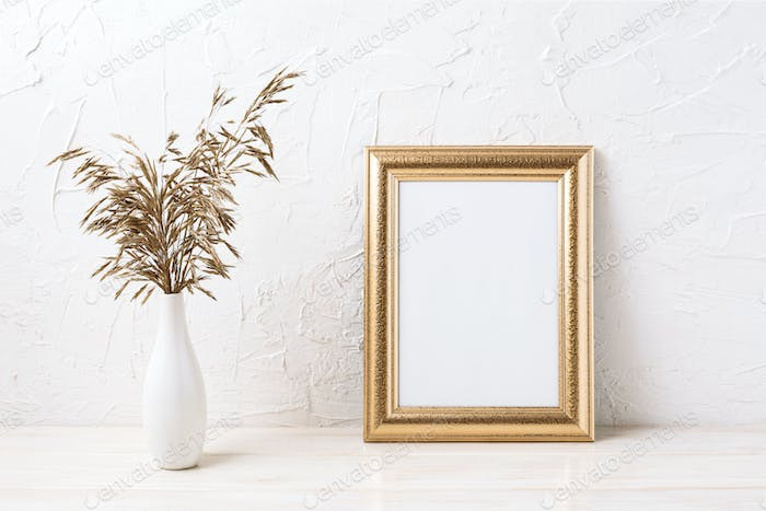 Golden  frame mockup with dried grass