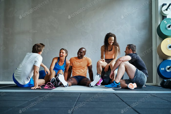 Friends relaxing together after a workout at the gym