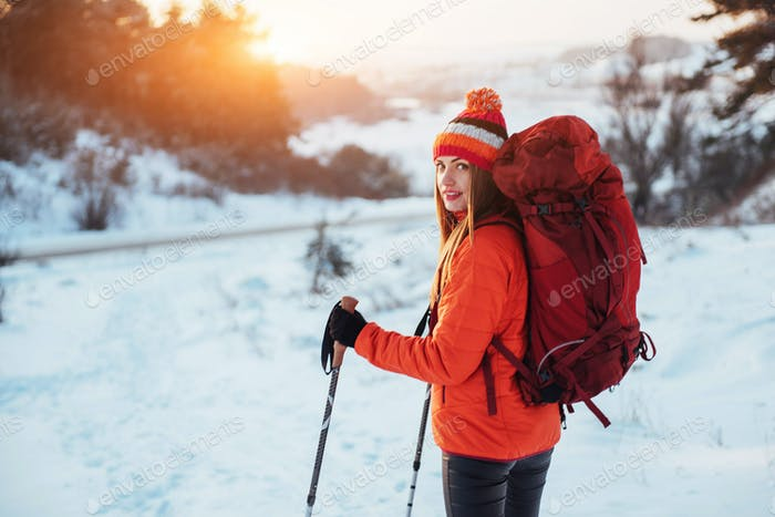 Woman Traveler with backpack hiking Travel Lifestyle adventure concept active vacations outdoor