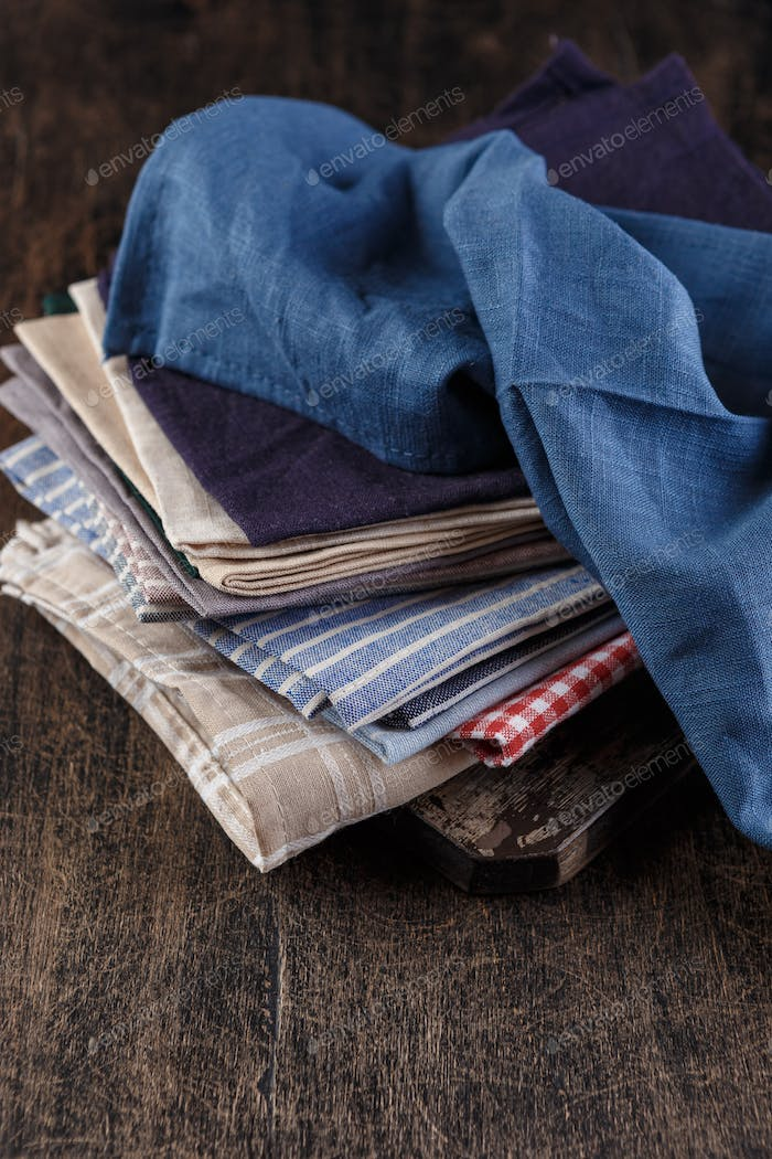 Stack textile napkins in different colors.