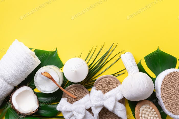 Skincare, beauty and spa concept with bath cosmetic accessories on yellow background. Flat lay. Top