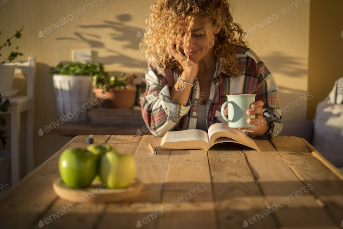 Beautiful curly adult woman read a book